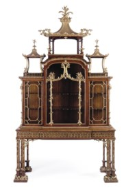 A GEORGE II PARCEL-GILT PADOUK CABINET-ON-STAND